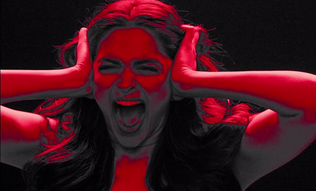Deepika Padukone screams with hands on ears.