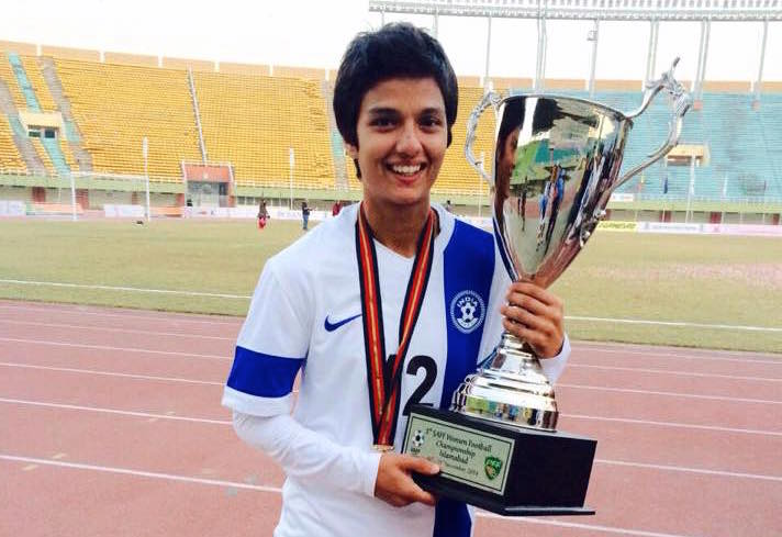 Jyoti posing with the cup that the Indian team won at the South Asian Football Federation Cup held in Pakistan in 2014.