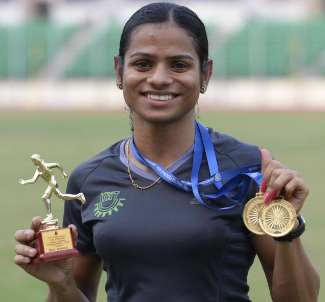 Picture of Dutee Chand holding her medal.