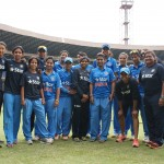A Group of Women Cricketers in Blue Uniforms