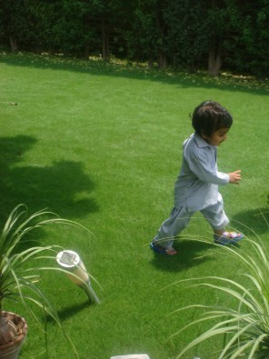 My little son, who now has an Australina passport, running in a garden in Pakistan.