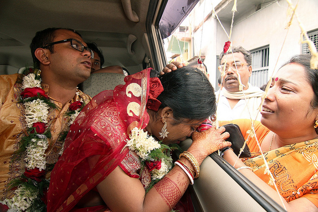 Newly Married couple bids farewell on their way to honeymoon.