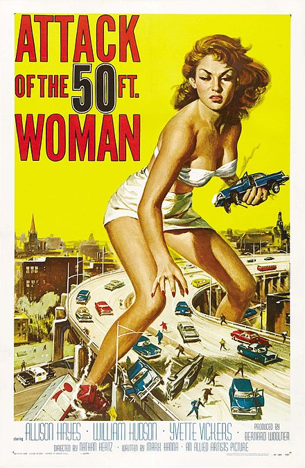 "Poster of film ""Attack of the 50 ft woman"" shows giant woman holding car in one hand."