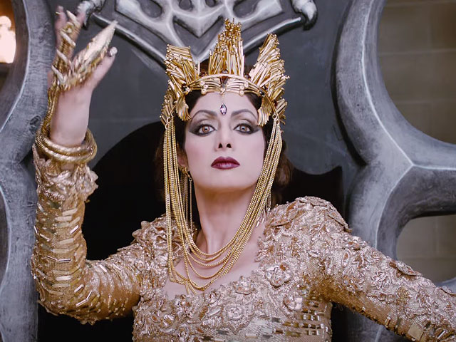 Picture of Sridevi in her negative role of Yavanarani, seated on a throne.