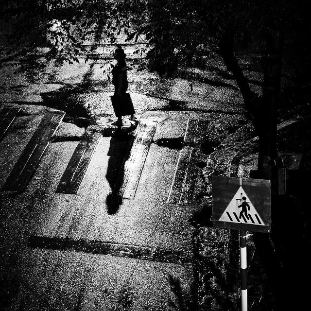 Woman walking in a dark alley.