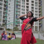 Woman in sari, singing