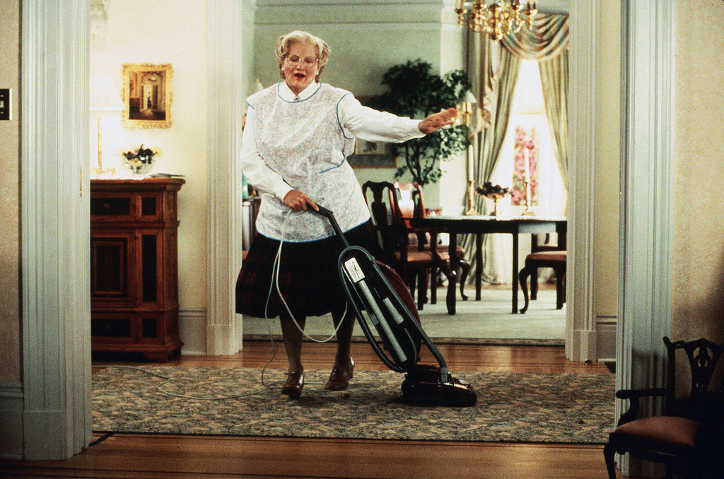 Robin Williams dressed as a woman in Mrs Doubtfire, hoovering.