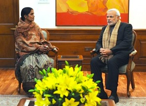 Photo of Asha Devi with Narendra Modi