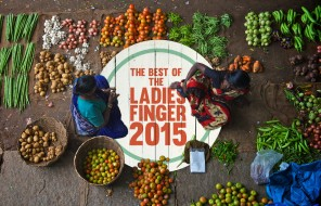 Two women at a vegetable market seen from above.