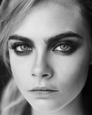 black and white close-up photogaph of model Cara Delevingne