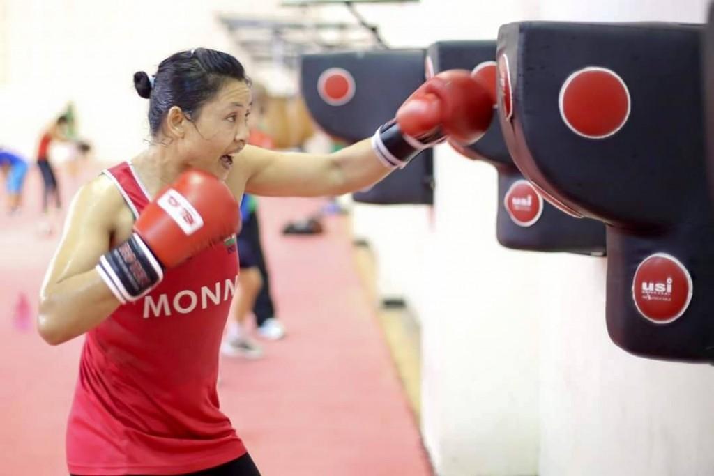 Woman boxer practising.