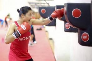 Women boxer practising.