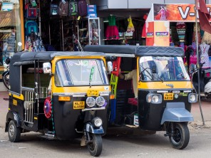 Two parked auto rickshaws.