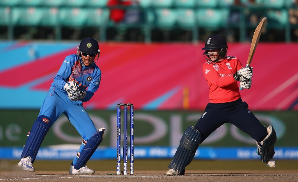 """""""DHARAMSALA, INDIA - MARCH 22: Tammy Beaumont of England hits the ball towards the boundary, as Sushma Verma of India looks on during the Women's ICC World Twenty20 India 2016 match between England and India at the HPCA Stadium on March 22, 2016 in Dharamsala, India. (Photo by Matthew Lewis-IDI/IDI via Getty Images)"""""""
