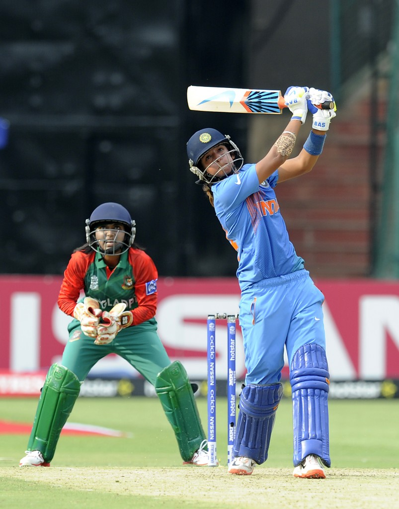 """Bangalore, INDIA - MARCH 15 : Harmanpreet Kaur of India bats during the Women's ICC World Twenty20 India 2016 match between India and Bangladesh at the Chinnaswamy stadium on March 15, 2016 in Bangalore, India. (Photo by Pal Pillai/IDI via Getty Images).."""