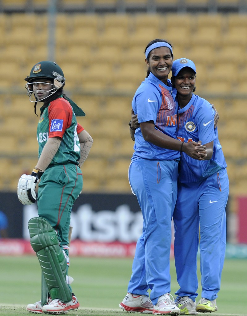 """Bangalore, INDIA - MARCH 15 : Deepti Sharma of India and Shikha Pandey of India celebrate the wicket of Sharmin Akter Supta of Bangladesh during the Women's ICC World Twenty20 India 2016 match between India and Bangladesh at the Chinnaswamy stadium on March 15, 2016 in Bangalore, India. (Photo by Pal Pillai/IDI via Getty Images).."""
