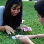 "Natalie Kline, 19 and David Pina, 18, play a game of Egyptian War on a break from their biology classes in the quad at California State University, Northridge on Thursday afternoon.  David said, ""She's the one that's winning!"""