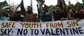 Pakistani youth shout slogans against Valentine's Day in Lahore on February 14, 2013. Pakistan's media regulator Wednesday asked  television and radio stations to avoid offending religious sentiments and corrupting the nation's youth in their Valentine's Day broadcasts.  AFP PHOTO/Arif ALI        (Photo credit should read Arif Ali/AFP/Getty Images)